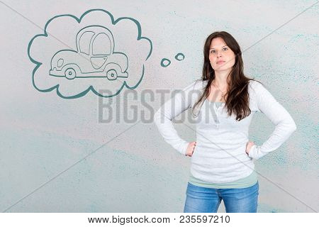 Dreamy Young Woman Thinking Of Buying A New Car Symbolized By Car In Thought Bubble As Concept In Fr