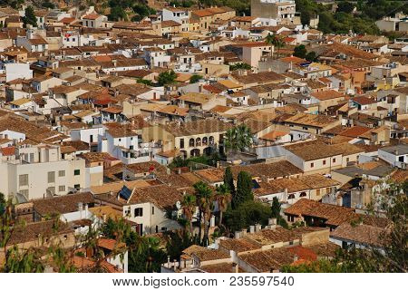 MAJORCA, SPAIN - SEPTEMBER 4, 2017: Looking down on the old town of Pollensa on the Spanish island of Majorca. In the North West of the island the town is a popular tourist destination.