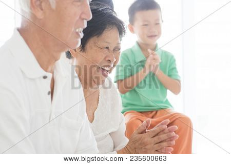 Happy Asian family relaxing at home, candid of multi generations people indoor lifestyle.
