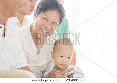 Happy Asian family at home, multi generations people indoor lifestyle.