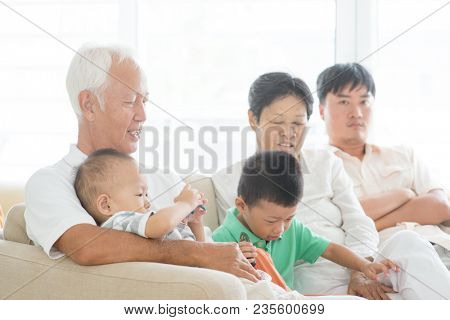 Candid of Asian family at home, multi generations people indoor lifestyle.