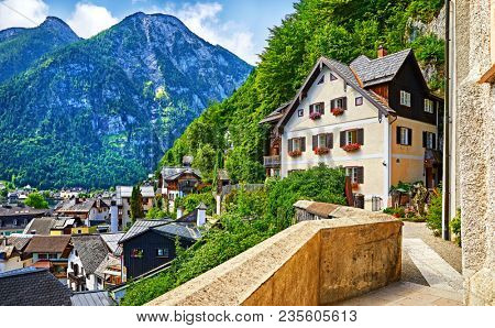 Hallstatt Austria vintage architecture and old houses in picturesque austrian mountains Alps on lake Hallstattersee. Paved stone walks among green trees.