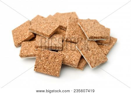Self-adhesive cork furniture protector pads isolated on white