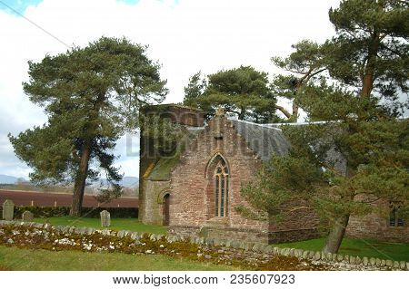 Perth, Scotland - April 7th 2017: Tulliburdine Chapel In Perthshire, With Pine Trees And Gravestone