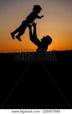 Loving Father And His Little Son Having Fan Together Outdoors. Happy Family. Fatherhood. Toddler Boy