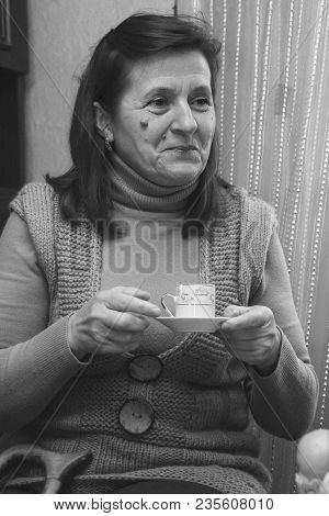 Pavlivka, Ukraine - 19 December 2008: Woman Reading Fortune With Cup Of Coffee At Home