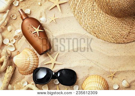 beach wear and accessories. summer hat, sandals, sunglasses, suntan lotion and seashells
