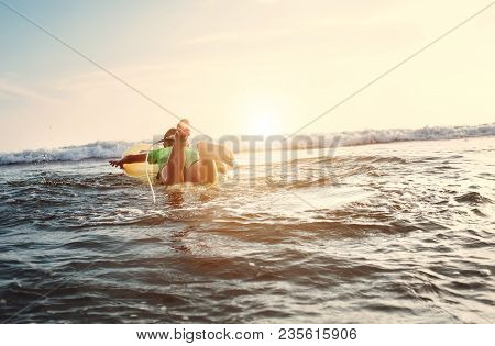 Boy Floats On Surf Board. Beginner Surfer, First Lessons