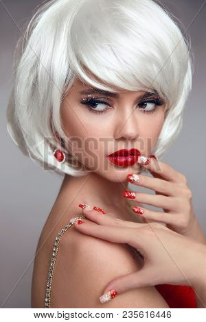 Christmas Red Lips Makeup And Manicured Nails. Beautiful Blonde Girl Closeup Portrait. White Short B