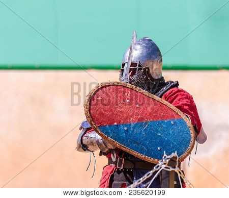 Goren, Israel, April 06, 2018 : Knight - A Participant In The Knight Festival Stands On The List Wai