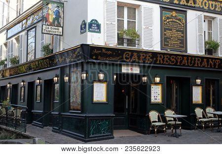PARIS, FRANCE - JANUARY 08: Cabaret restaurant La Bonne Franquette. Corner rue des Saules and rue Saint Rustique in Paris, France on January 08, 2018.