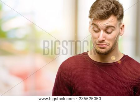 Handsome young man having skeptical and dissatisfied look expressing Distrust, skepticism and doubt