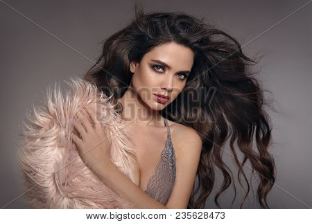 Fashion Studio Photo Of Gorgeous Sexy Brunette Woman With Long Healthy Hair And Evening Makeup Posin
