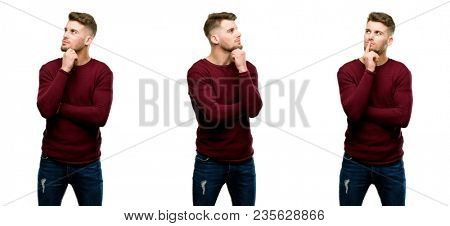Handsome blond man thinking and looking up expressing doubt and wonder isolated over white background