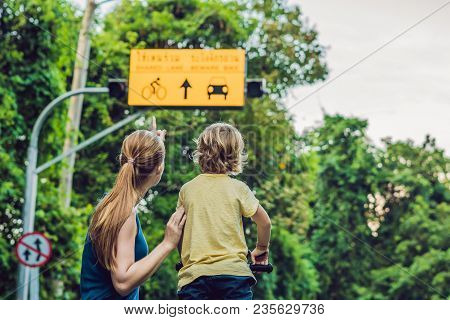 Mom Shows His Son A Plate Of Shared Lane And Beware Bike Warning Sign.