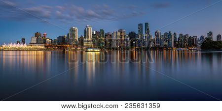 Night Skyline Of Vancouver Downtown As Seen From Stanley Park, British Columbia, Canada . Long Expos
