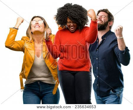Group of three young men and women happy and excited expressing winning gesture. Successful and celebrating victory, triumphant