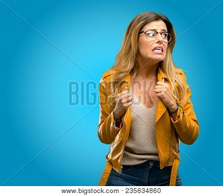 Beautiful young woman happy and excited celebrating victory expressing big success, power, energy and positive emotions. Celebrates new job joyful, blue background