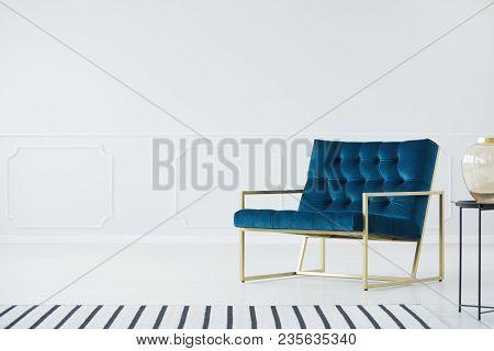Minimalist Interior With Blue Armchair