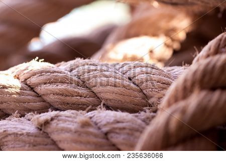 Durable Thick Sea Rope Close-up For Yachting, Navigation, Rigging, Tying Of Various Cargoes