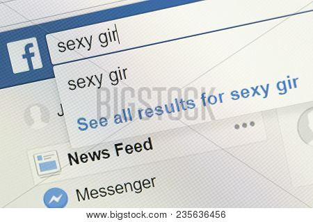Houilles, France - April 10, 2018:sexy Girl Word Writes In The Search Bar Of Facebook To Illustrate