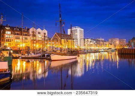 Marina at Motlawa river in Gdansk at night, Poland