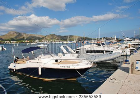 MAJORCA, SPAIN - SEPTEMBER 4, 2017: Power boats moored in the marina at Puerto Pollensa on the Spanish island of Majorca. The seaside destination is the most Northerly town on the island.