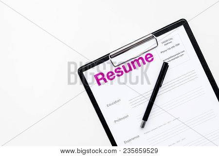 Looking For Work Concept. Resume On Padwith On White Background Top View.