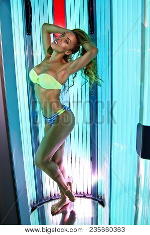The Girl Is Tanning In The Tanning Bed