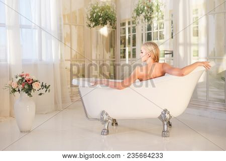 Beautiful Young Blond Woman Relaxing In A Bath