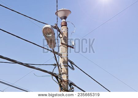 Electricity Power Mast Close Up. Mess Of Wires Cables. Electricity Pole Concept. Power Tower. High V