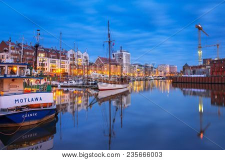 Gdansk, Poland - April 5, 2018: Marina at Motlawa river in Gdansk at night, Poland. Gdansk is the historical capital of Polish Pomerania.