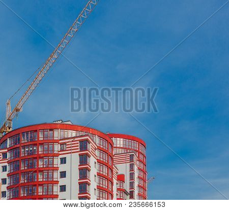 Construction Site Of A New Apartment High Building Against Blue Sky. Residential Area Development. R