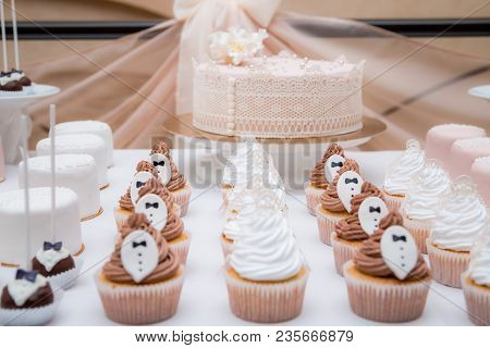 wedding candy bar cap cakes white brown. close-up poster