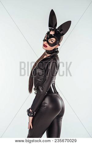 Kinky Woman In Sexy Costume And Mask With Ears Isolated On White