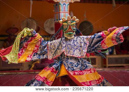 Unidentified monk in mask perform a religious masked and costumed mystery dance of Tibetan Buddhism during the Yuru Kabgyat Buddhist festival at Lamayuru Gompa, Ladakh.