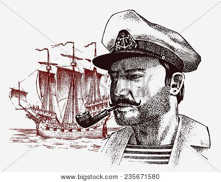 Sea Captain Against The Background Of Sailboat, Marine Sailor With Pipe, Bluejacket. Portrait Of The