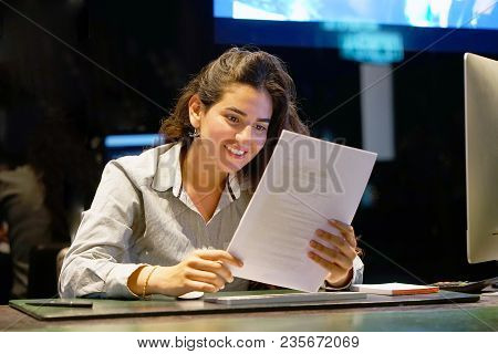 Close-up Of Hotel Administrator. A Woman-reception Worker Happy Lady, Enjoying The Good News In Writ