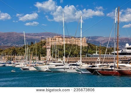White luxury yachts moored in port of Antibes - -famous city on French Riviera.