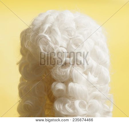 Judge Wig Accessories On A Yellow Background.
