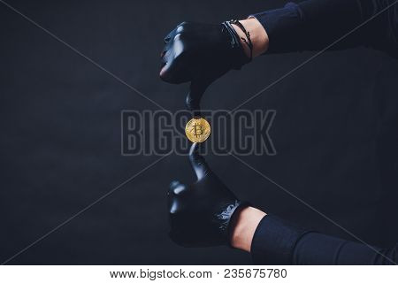 Bitcoins Placed On Arm Hands In Black Gloves Show Symbol.