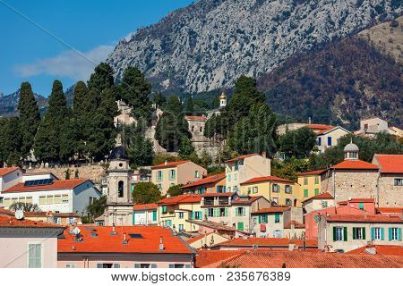View of colorful houses with red roofs in Old Town of Menton, France.