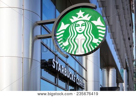 Gdansk, Poland - April 4, 2018: Starbucks sign outside a coffee shop in Gdansk, Poland. Starbucks Corporation is an American coffee company and the largest coffeehouse company in the world.