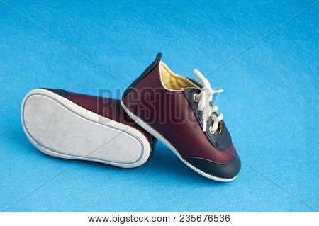 Cute Sport Shoes For Small Boy Isolated On Blue Background. Little Baby Sneakers. Stylish Leather Ch