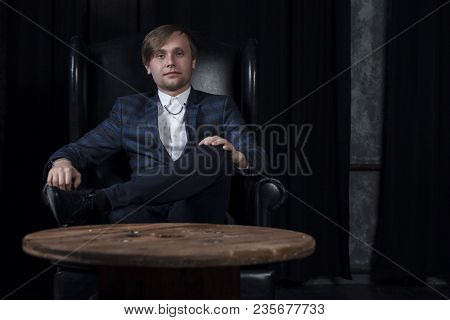 Handsome Attractive Elegant Classic Man Wearing Trendy Suit, With Beard, Sitting And Having Rest On