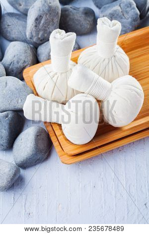 thai herbal compress massage with pebbles - beauty treatment