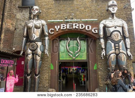 London, United Kingdom -- March 23, 2018: People Gather In Front Of The Giant Robots At The Entrance