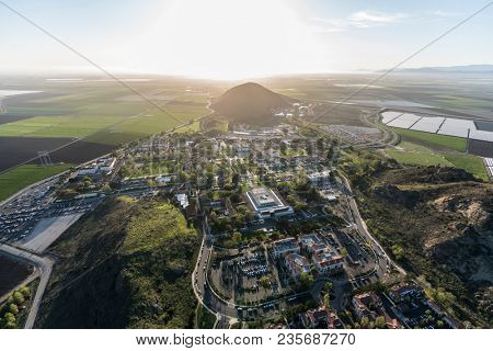 Camarillo, California, USA - March 26, 2018:  Afternoon aerial view of Ventura County farm fields and California State University Channel Islands campus.