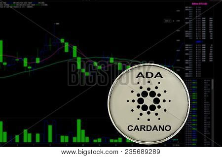 Coin Cryptocurrency Cardano On A Background Chart. Ada.