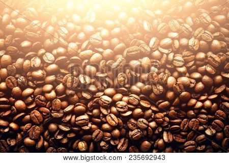 Roasted coffee beans backgound, copy space, top view. Cappuccino, dark espresso, aroma black caffeine drink, ingredient for coffee beverage. Macro shoot. poster